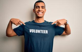 """man wearing shirt that says """"volunteer"""""""